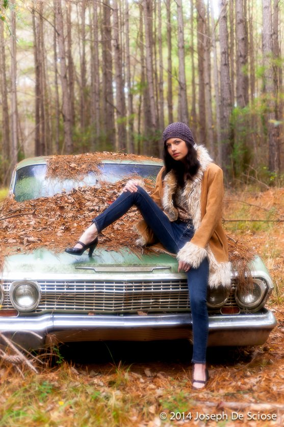 The Impala, Portrait of a young woman sitting on an old Impala.