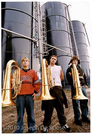 Atlantic, Iowa High School Tuba players in front of 3 corn silos