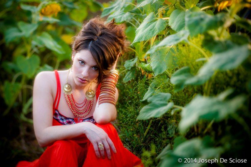 Portrait of a woman amongst sunflowers.