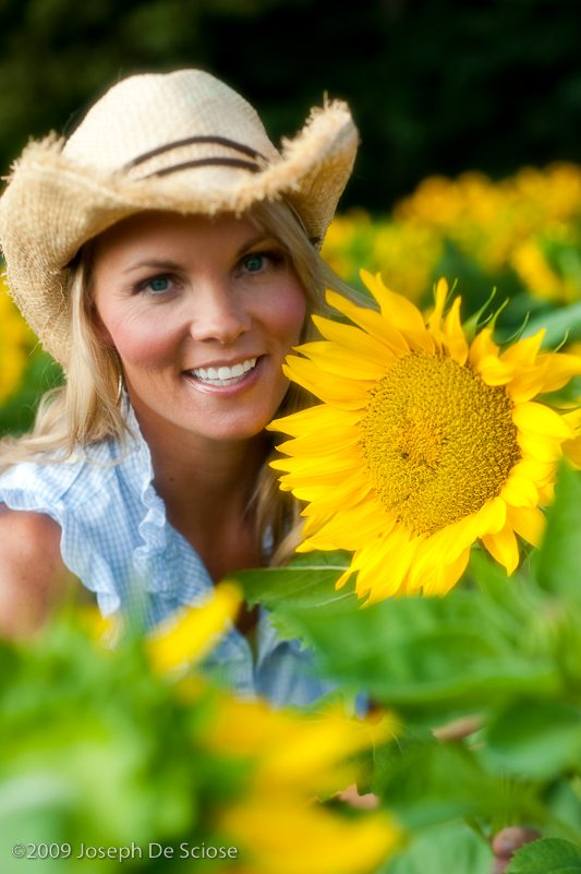Pretty blond woman with Sunflowers