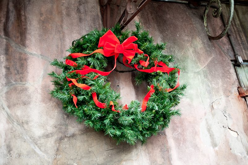Christmas wreath hanging on a wall in the French Quarter in New Orleans.