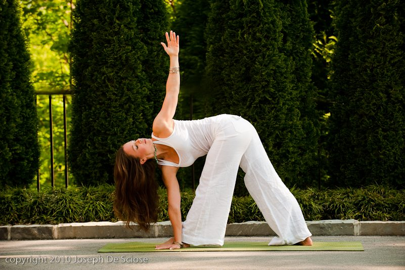 Woman doing a yoga posture in an outdoor setting.