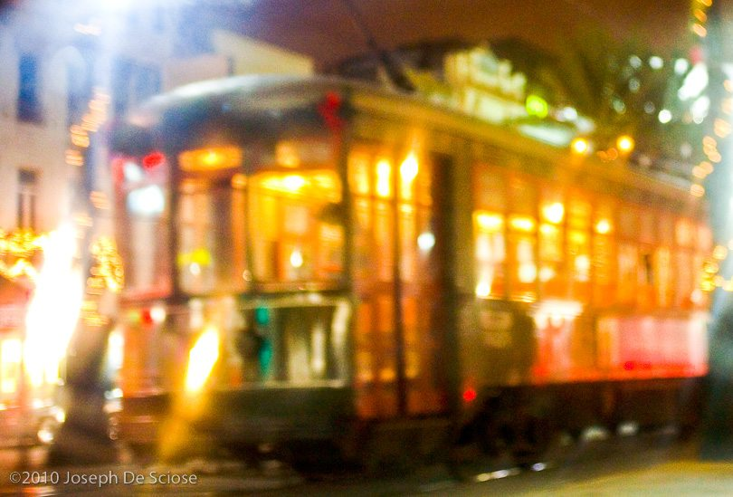 A brightly lit street car on Canal Street in New Orleans.