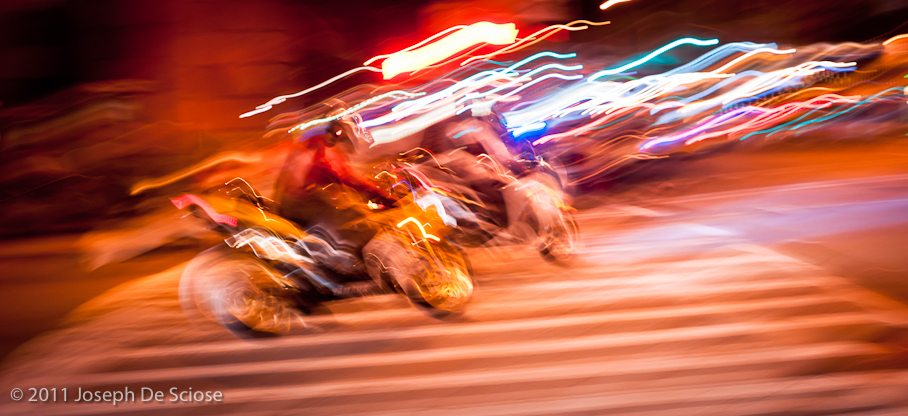 Motorcycles buzzing New York at night, photograph Joseph De Sciose