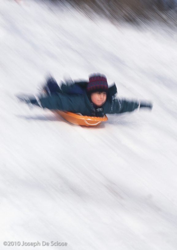 Tobogganing in Central Park, New York City, snow
