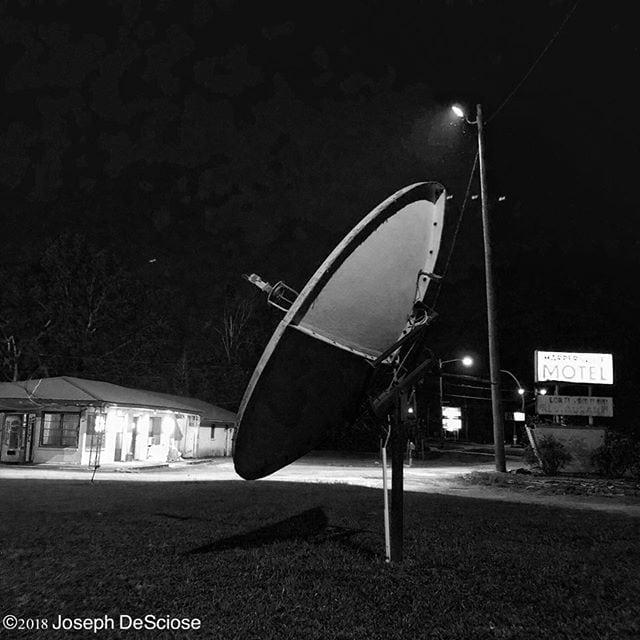 Searching for intelligent life #motel #satelliteantenna #architecture #seedy #mysterious #night #shadows #rundown