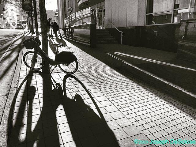 Bike shadows #commercialphotography #editorialphotography #travel #atlanta #perspective  #lines #vanishingpoint #streetphotography #texture #sidewalk #city