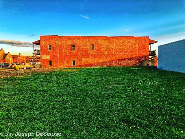 Grass, bricks, sky #fineartphotography #commercialphotography #alabama #architecture #grass #building #geometric #landscapephotography #landscape #green #blue #space